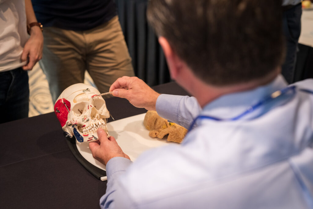 Dr. Roberts reviewing facial anatomy with other doctors.