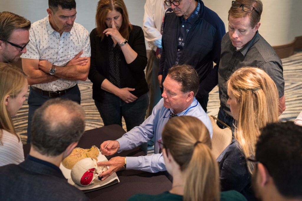 Dr. Roberts reviewing anatomy with doctors prior to learning how to inject Botox.