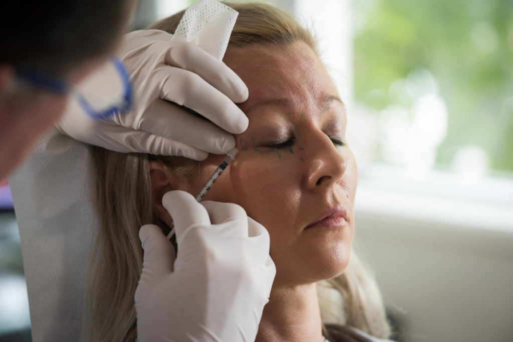 woman receiving careful botox injection from highly trained dentist